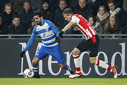 (L-R) Youness Mokhtar of PEC Zwolle, Daniel Schwaab of PSV during the Dutch Eredivisie match between PSV Eindhoven and PEC Zwolle at the Phillips stadium on February 03, 2018 in Eindhoven, The Netherlands