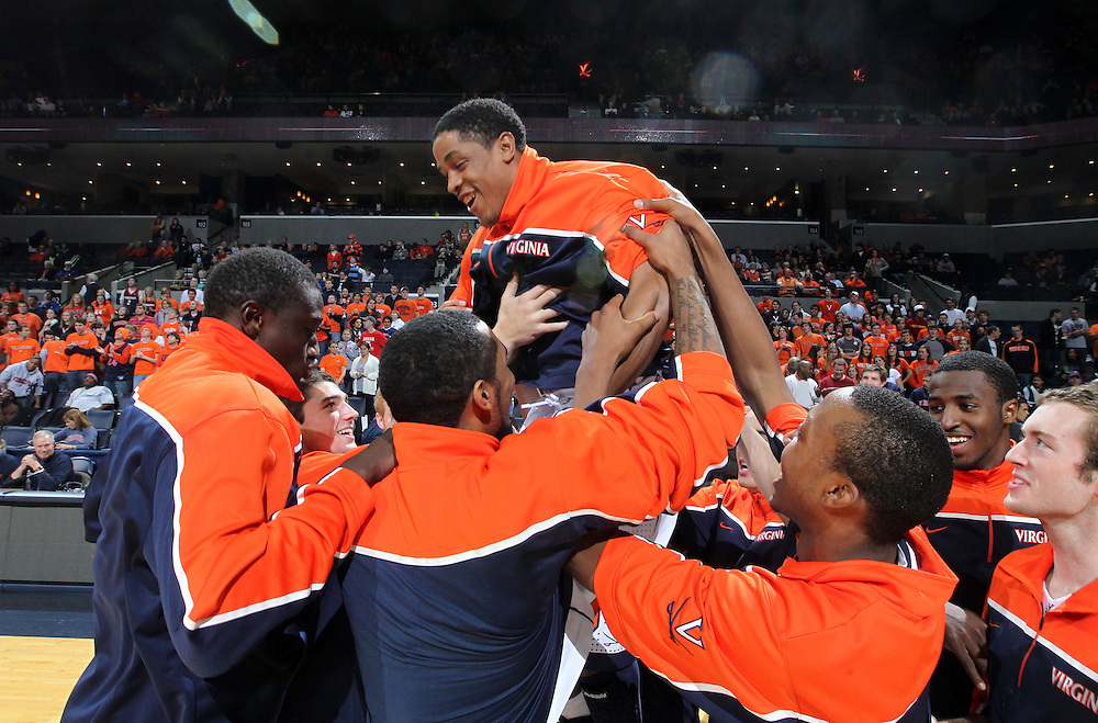 Dec. 07, 2010; Charlottesville, VA, USA;  Virginia Cavaliers guard Jontel Evans (1) is lifted by his teammates before the start of the game against the Radford Highlanders at the John Paul Jones Arena. Mandatory Credit: Andrew Shurtleff