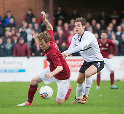 Linlithgow Rose Roddy MacLennan and Raith Rovers Kevin Moon.<br /> Linlithgow Rose 0 v 2 Raith Rovers, William Hill Scottish Cup Third Round game player today at Prestonfield.