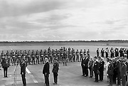 President John F. Kennedy arrives at Dublin Airport.  Kennedy replies to President de Valera's speech of welcome.  Onlookers include President Kennedy's sisters, Mrs. Eunice Shriver and Mrs. Jean Smith; An Taoiseach Seán Lemass; An Tanaiste Mr. McAntee; Dr. James Ryan, Minister for Finance, and Mr. Frank Aiken, Minister for External Affairs.<br /> 26.06.1963