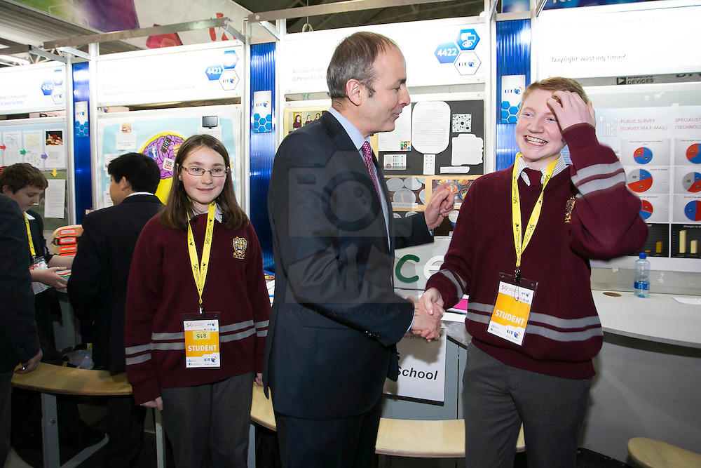 """Repro Free: 08/01/2014 <br /> Fianna Fail leader Micheál Martin TD is pictured with Anna Mustata and Jason Lenihan from Bishopstown Community School, Cork and their project """"An investigation of the different cutlery on perception of food"""" at the BT Young Scientist & Technology Exhibition 2014 in the RDS Dublin. Picture Andres Poveda"""