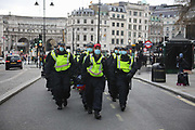 Kill the Bill demonstration in Central London against the proposed Police, Crime, Sentencing and Courts Bill on the 3rd April 2021, London, United Kingdom. Police move down the Strand from Trafalgar Square. After the protest ended in Parliament Square police cleared the streets, arresting several in the process. Thousands turned out in London and across the UK to show their objection to the Governments proposed bill. Many fear the bill is meant to suppress acts of protesting and demonstrations. The police will be given greater powers to prevent and stop actions of civil disobedience and peaceful protests and many see this as a suppression of their civil liberties. Sentencing for acts of peaceful protest is also likely to be much harsher and that may also act as a deterrent to protest.