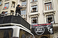 """A speaker addresses the crowd during the remembrance. Rally members, remembering the death of editor-in-chief of the bilingual Turkish-Armenian newspaper Agos, Hrant Dink, wore scarves and held placards stating """"We are all Hrant, We are all Armenia""""."""