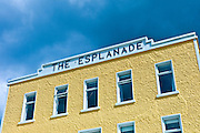 Brightly coloured Esplanade Hotel on the seafront at Kilkee popular beach resort, County Clare, West Coast of Ireland