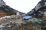 KAILI, CHINA - (CHINA OUT) <br /> <br /> Hope Primary School Turned Into Waste Recycling Station In Guizhou<br /> <br /> piles of recycling at Laoshan Village Hope Primary School  in Kaili, Guizhou Province of China. The school located in Laoshan village was built in November 2008, with a donation of 200,000 yuan from Hong Kong Ling Chuan Charitable Foundation Limited and 150,000 yuan from Kaili city government. But it has turned into a waste recycling station. <br /> ©Exclusivepix