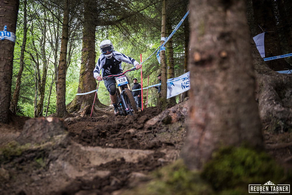 Cole Lucas finding his way in through the woods during his qualifying round at the UCI Mountain Bike World Cup in Fort William, Scotland.