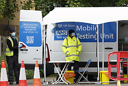 © Licensed to London News Pictures. 25/05/2021. London, UK. A mobile Covid-19 testing site has been set up in a car park in Hounslow, west London. The government have advised against travel in eight areas in England, including the London borough of Housnlow, because of the rising number of Covid-19 infections due to the Indian variant of the disease. Photo credit: Peter Macdiarmid/LNP