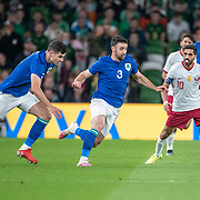 DUBLIN, IRELAND:  October 12:  Enda Stevens #3 of Republic of Ireland and John Egan #5 of Republic of Ireland  watched by Hasan Al Haydos #10 of Qatar during the Republic of Ireland V Qatar International friendly match at Aviva Stadium on October 12th, 2021 in Dublin, Ireland. (Photo by Tim Clayton/Corbis via Getty Images)