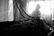 Rabia waits to have her c-section done by the visiting doctors and surgeons from Karachi that passed through her area during a surgical camp tour across the Sindh province. Thari Mirwah, Pakistan, 2010