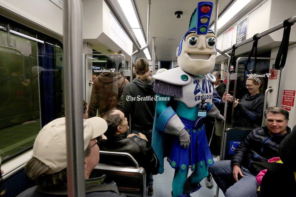 Zap Gridlock joins the riders of the U Link train on launch day for Sound Transit's light-rail from Capitol Hill station to the University Station at Husky Stadium on Sat. March 19, 2016<br /> <br /> Alan Berner / The Seattle Times
