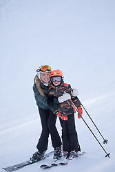 mother and her son on a ski mountain together