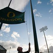 Raising the University of Oregon's flag near the football stadium.