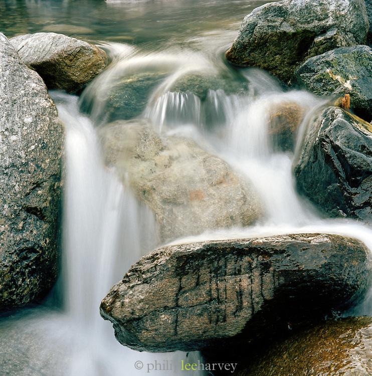 Waterfall flowing over boulders, Ischgl, Austrian Tirol, Austria.