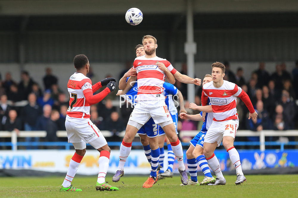 Andy Williams challenged by Niall Canavan during the Sky Bet League 1 match between Rochdale and Doncaster Rovers at Spotland, Rochdale, England on 2 April 2016. Photo by Daniel Youngs.