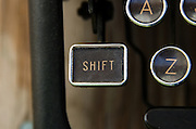 "Close-up of antique typewriter ""shift"" key."
