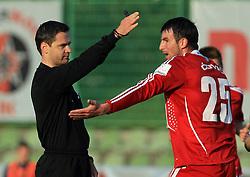 Referee Damir Skomina and Mehmedalija Covic of Interblock  at 1st semifinal match of Pokal Hervis between NK Interblock and NK Maribor at  ZAK Stadium, on April 15, 2009, in Ljubljana, Slovenia.  (Photo by Vid Ponikvar / Sportida)