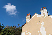 Paint has peeled away from the wall of an end-of-terrace house in Greenwich, on 16th September 2021, in London, England.