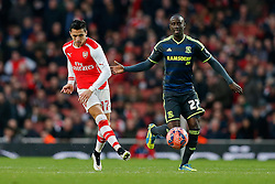 Alexis Sanchez of Arsenal is challenged by Albert Adomah of Middlesbrough - Photo mandatory by-line: Rogan Thomson/JMP - 07966 386802 - 15/02/2015 - SPORT - FOOTBALL - London, England - Emirates Stadium - Arsenal v Middlesbrough - FA Cup Fifth Round Proper.