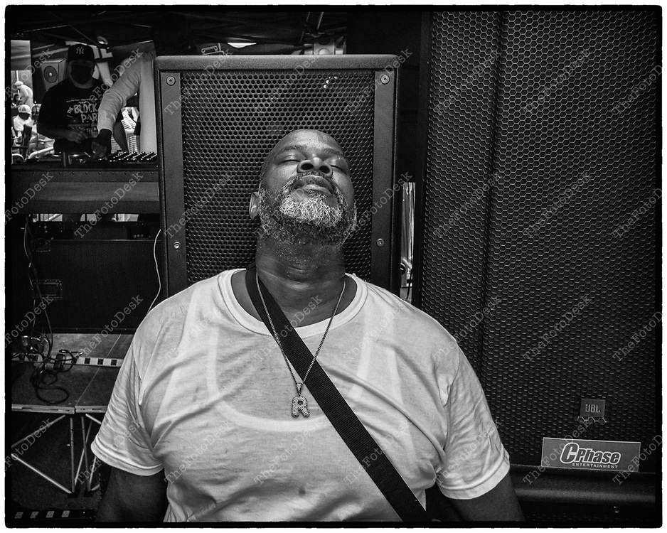 NEWARK, NEW JERSEY: Malik, A house head rest the back of his heads on a set a speakers at full blasts at a 120 DB  during the weekly Block Party on Edison Plaice in Newark, NJ on Friday, July 30, 2021 (Brian B Price/TheFotodesk).