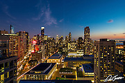 Sunset view from the terrace of the penthouse at 1965 Broadway in New York City, looking over Lincoln Center and showing the Tribute in Lights for the World Trade Center. Photographed on September 11th, 2014.