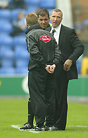 Photo: Aidan Ellis.<br /> Wigan Athletic v Newcastle United. The Barclays Premiership. 15/10/2005.<br /> newcastle manager Graeme Souness is spoken to by referee Mr P Dowd