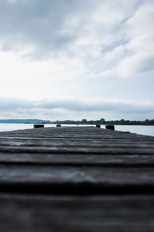 Landing stage wooden jetty lake water cloudy