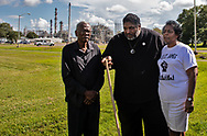 Sharon Lavigne, founder of Rise St. James, Robert Taylor, and Rev. William Barber, leader of the Poor People's Campaign  in front of the Denka/DuPont plant in St. John The Baptist, near Taylors home. Barber has been trying to bring attention to the plight of those in Cancer  Alley by challenging all of the democratic presidential candidates to visit Lavigne and Taylor in Louisiana and talk to the about environmental justice.