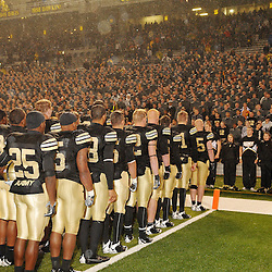 Oct 23, 2009; West Point, N.Y., USA; Army players join their fellow cadets in singing the United States Military Academy alma mater after Rutgers' 27 - 10 victory over Army at Michie Stadium.