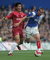 Photo: Lee Earle.<br /> Portsmouth v Reading. The Barclays Premiership. 28/10/2006. Reading's Seol Ki- Hyeon (L) battles with Matt Taylor.