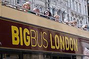 With many people and families staying in the UK for their Summer break during the school holidays, a large number of domestic tourists, who may normally have been travelling abroad, have decended on the capital to see the sights, as seen here with a passing sightseeing hop-on, hop-off tour bus full of sightseers on 11th August 2021 in London, United Kingdom. Following the Coronavirus / Covid-19 health scare of the last two years, and with some travel restrictions still in place, more people have chosen a staycation which is a holiday spent in ones home country rather than abroad, or one spent at home and involving day trips to local attractions.
