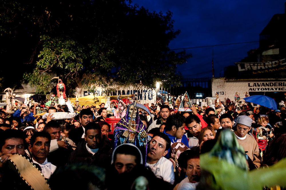 Hundreds of Sante Muerte followers pray together during a Rosary ceremony outside of the Tipito Shrine in Mexico City.