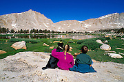 Kids and dog at Cottonwood Lakes, John Muir Wilderness, Sierra Nevada Mountains, California USA