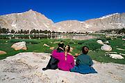 Kids and dog at Cottonwood Lakes, John Muir Wilderness, Sierra Nevada Mountains, California USA