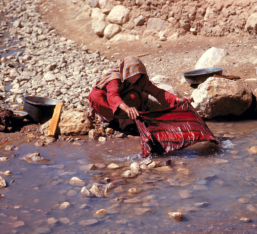 A woman washes fabric in a stream in the Bamian Valley of Afghanistan.