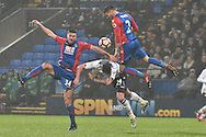 Bolton Wanderers Midfielder, James Henry (24) tackled by Crystal Palace Defender, Joel Ward (2) ansd Crystal Palace Defender,  Martin Kelly (34) during the The FA Cup 3rd round match between Bolton Wanderers and Crystal Palace at the Macron Stadium, Bolton, England on 7 January 2017. Photo by Mark Pollitt.