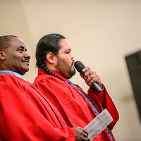 060515  Adron Gardner/Independent<br /> <br /> New Life Learning programs executive director Benson Ndolo, left, is introduced by Aaron Nez during the New Life Learning GED program graduation at the Lighthouse Church in Gallup Friday.