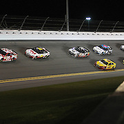Kevin Harvick (29) leads the race as the field exits turn four during the NASCAR Sprint Unlimited Race at Daytona International Speedway on Saturday, February 16, 2013 in Daytona Beach, Florida.  (AP Photo/Alex Menendez)