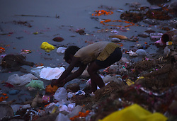 September 5, 2017 - Allahabad, Uttar Pradesh, india - Allahabad: An Indian child girl searches for coin after Hindu Devotee immerse Lord Ganesha's idol in a pond near River Ganga on the occasion of Anant Chaturdasi festival celebration in Allahabad on 05-09-2017. (Credit Image: © Prabhat Kumar Verma via ZUMA Wire)