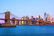 New York Skyline with Brooklyn Bridge, East River and Financial District of Manhattan, with One World Trade Center, New York City.