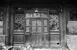 Detail of old timber doorway of a house in a Beijing hutong before it was demolished