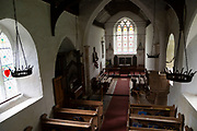 Interior of parish church of Saint Mary, Battisford , Suffolk, England view of nave, chancel and east window