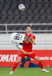 HELSINKI, FINLAND - Thursday, September 3, 2020: Wales' Kieffer Moore (R) and Finland's Jere Uronen during the UEFA Nations League Group Stage League B Group 4 match between Finland and Wales at the Helsingin Olympiastadion. Wales won 1-0. (Pic by Jussi Eskola/Propaganda)