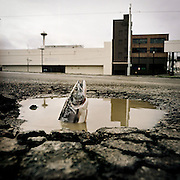 PUGET SOUND; FOOTPRINT; SALMON IN POTHOLE; PARKING LOT<br /> Photo Illustration by Tom Reese / Special to the Seattle Times<br /> Personal photo