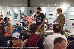 Custom builder and tattoo artist AJ Harris of Dallas, TX speaking about his Royal Enfield on display at the Old Iron - Young Blood exhibition media and industry reception in the Motorcycles as Art gallery at the Buffalo Chip during the annual Sturgis Black Hills Motorcycle Rally. Sturgis, SD. USA. Sunday August 6, 2017. Photography ©2017 Michael Lichter.