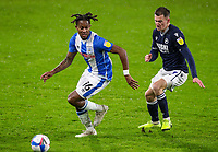 Huddersfield Town's Rolando Aarons gets away from Millwall's Jed Wallace<br /> <br /> Photographer Alex Dodd/CameraSport<br /> <br /> The EFL Sky Bet Championship - Huddersfield Town v Millwall - Wednesday 20th January 2021 - The John Smith's Stadium - Huddersfield<br /> <br /> World Copyright © 2021 CameraSport. All rights reserved. 43 Linden Ave. Countesthorpe. Leicester. England. LE8 5PG - Tel: +44 (0) 116 277 4147 - admin@camerasport.com - www.camerasport.com
