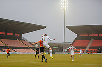 Football - 2020 / 2021 Emirates FA Cup - Round 2 - Barnet vs Milton Keynes Dons - The Hive<br /> <br /> Richard Keogh (MK Dons) and Ben Nugent (Barnet FC) compete for the header on a misty afternoon under the floodlights<br /> <br /> COLORSPORT/DANIEL BEARHAM