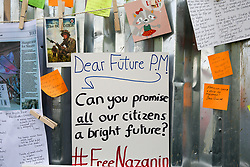 """© Licensed to London News Pictures. 21/06/2019. London, UK. A message for the future British Prime Minister outside the Iranian Embassy where Richard Ratcliffe, the husband of imprisoned Iranian-British national Nazanin Zaghari-Ratcliffe who is on the seventh day of a hunger strike, in solidarity with his wife, who is refusing to eat in protest at her """"unfair imprisonment"""" in Iran on spying charges. Photo credit: Dinendra Haria/LNP"""