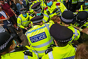 London, United Kingdom, June 27, 2021: Police scuffle with a protestor as they struggle to restrain and arrest him during an anti-government musical rave in central London on Sunday, June 27, 2021. (VX Photo/ Vudi Xhymshiti)