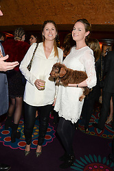 Left to right, JESSICA HOWLETT and EUGENIE WARRE at Tatler Magazine's Little Black Book Party held at Annabel's, Berkeley Square, London on 5th November 2013.