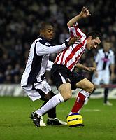 Photo: Dave Linney.<br />West Bromwich Albion v Sunderland. The Barclays Premiership. 21/01/2006Sunderland's .Gary Breen (R)keeps Nathan Ellington at bay